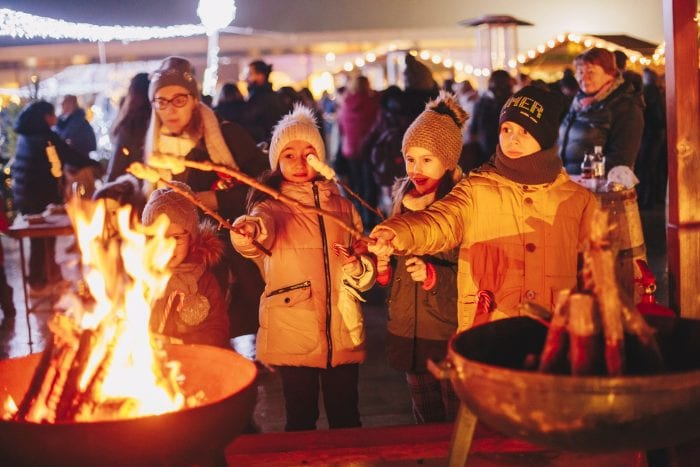 Christmas markets children toasting marshmallows. Local wine day. Public annual events and outdoor concerts.